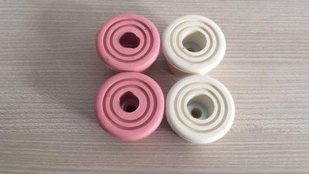 frenos goma patinaje artistico color rosas y blancos